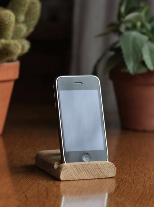 A Leanii phone stand with a small black iPhone