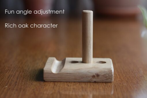"Leanii oak phone stand without phone and writing ""Fun angle adjustment, Rich oak character"""