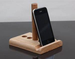 Oak tablet stand black background