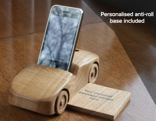 "Oak wood phone stand in the shape of a car - front and side view with base and text reading ""Personalised anti-roll base included"""