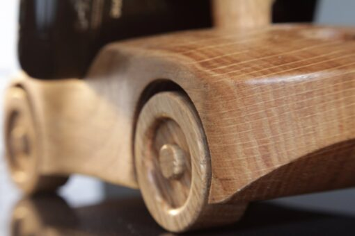 Oak wood phone stand in the shape of a car - view of rear close-up