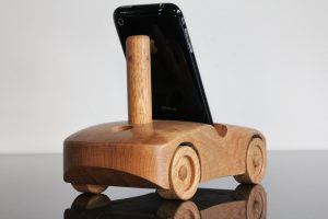 Oak wood phone stand in the shape of a car - view of rear