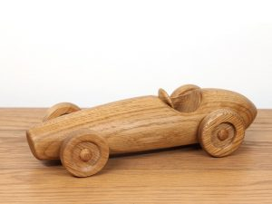 Photograph of a hand made oak car based on the Ferrari F2 500 1953 race car