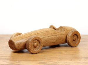 Photograph of a hand made oak car based on the Ferrari F2 500 1953 race car